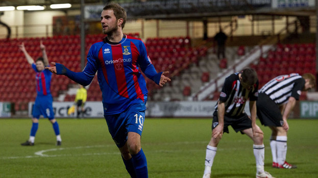 Super-sub Andrew Shinnie wheels away to celebrate after his excellent strike gave Inverness CT the lead.
