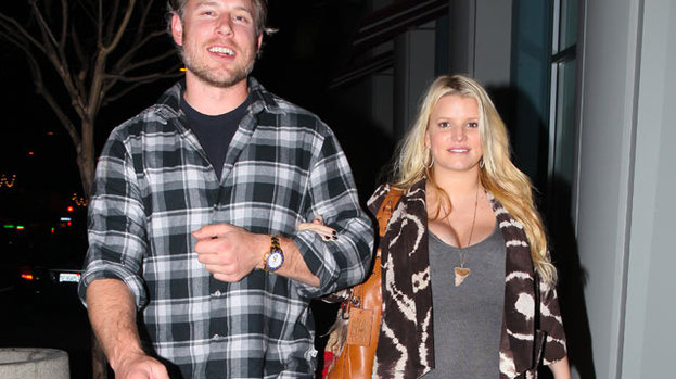 Baby love: Jessica Simpson (with Eric Johnson) showing off her growing baby bump back in January