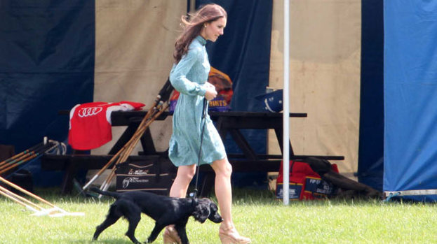 Puppy love: Kate Middleton walks little Lupo around Cowarth Park