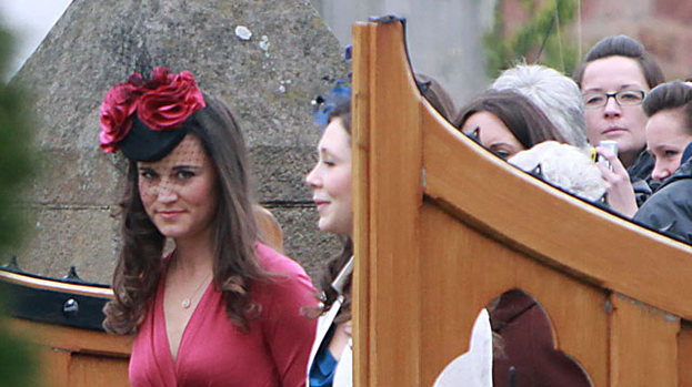 Lady in Red: Pippa turned heads at the wedding of Camilla Hook and Sam Holland