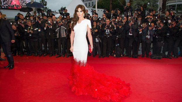 Red hot: Cheryl Cole looked stunning in a full length white gown with scarlet train