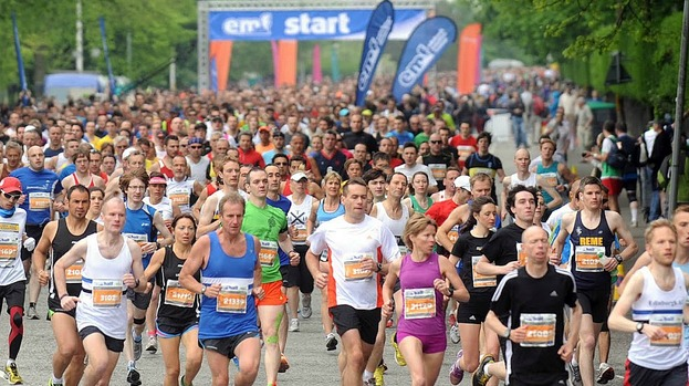 Pace setters: Runners hit the first corner from the city centre start point