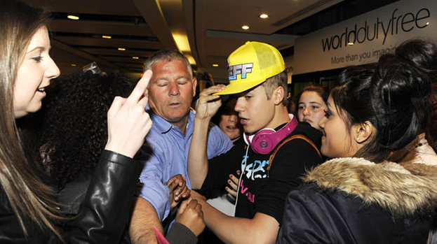 Fan frenzy: Justin Bieber is mobbed followers wherever he goes