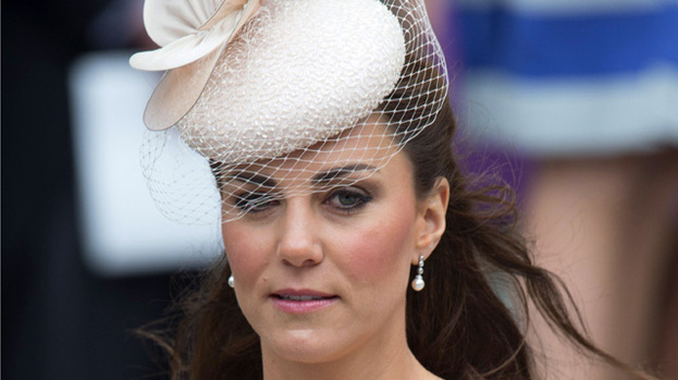 Thrifty Duchess: Kate Middleton wears the earrings in question at Tuesday's Diamond Jubilee celebrations