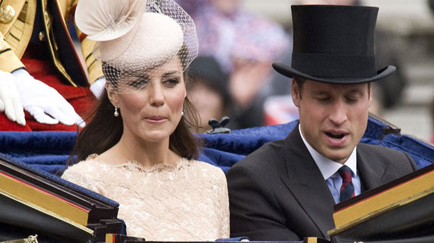 Queen of style: Kate Middleton sits in a carriage alongside husband Prince William at the Diamond Jubilee