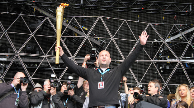 Light of my life: festival boss Jim King with the Olympic Torch