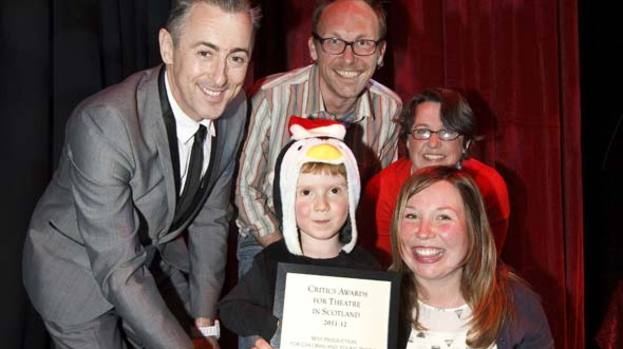 P-p-p- pick up: Alan Cumming and a very young penguin collecting the CATS award for best children's show