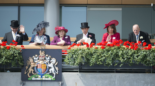 Right Royal day out: Carole Middleton (in red) laughs with Prince Philip (far right). Michael Middleton sits far left