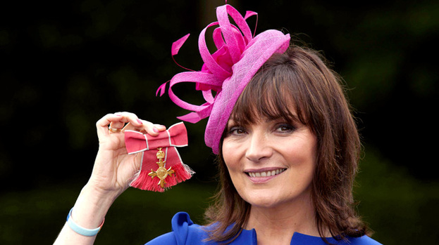 Such an honour: Lorraine Kelly holds her OBE
