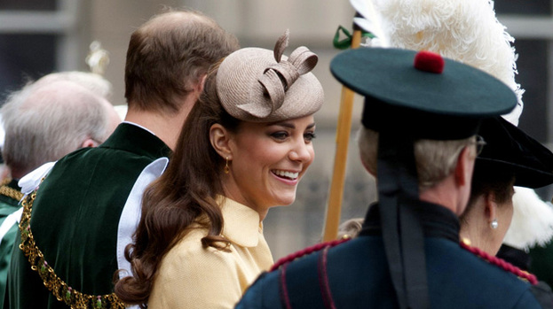 Pretty as a primrose: Duchess Kate looked summery in a yellow coat dress