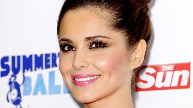 Stamping her authority: Cheryl only likes men with good shoes