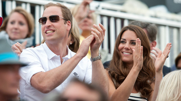 Jumping for joy: Duchess Kate and Prince William were delighted to watch Zara's team win silver at the Olympics