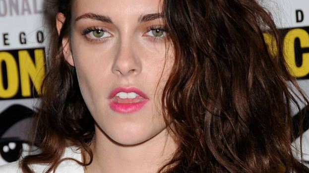 Kristen looked glam at Comic Con: but glum in LA
