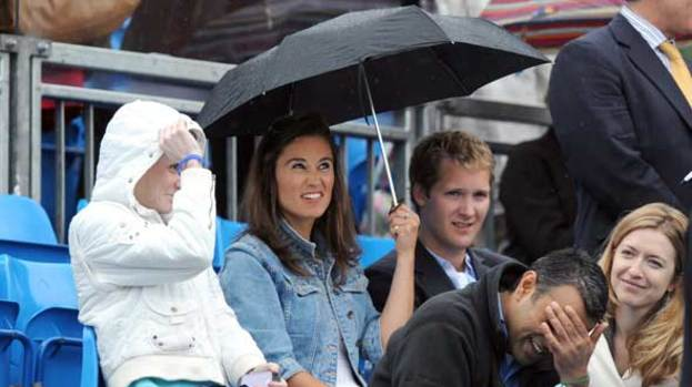 You can stand under my umbrella: Pippa not amused by summer shower