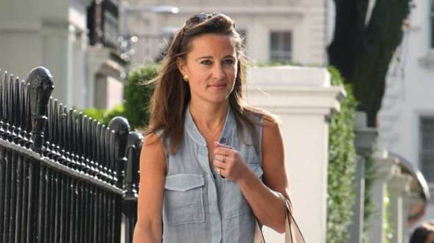 Perfect Pippa: the 27-year-old joined her mum and dad for a beach party at the Goring Hotel