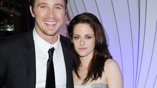 What a man: Kristen Stewart gets cosy with Man of the Year Garrett Hedlund