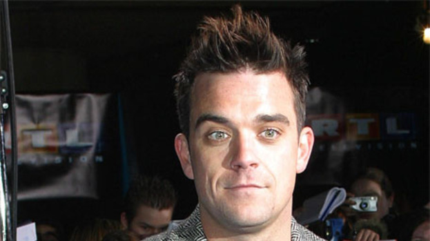 Robbie Williams' cake apology