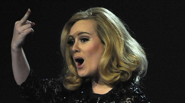 Fingering, the culprit: Adele gestures after being asked to leave the stage during her acceptance speech