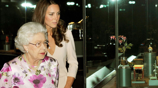 One thinks she is rather lovely: the Queen gives Kate the royal seal of approval