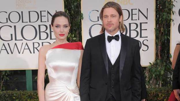 Top advice: Angelina (pictured with partner Brad Pitt) has reportedly been giving Johnny Depp relationship advice