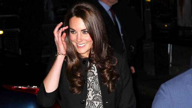 She's in style: Kate Middleton shows off the dress that's caused a huge rush on the high street