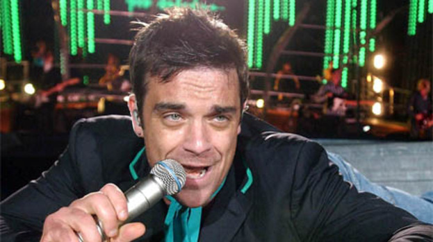 Robbie Williams confirms return