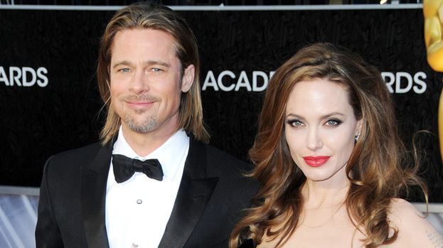 We're going on a summer holiday: Brad, Angelina and their six kids are being tipped for a holiday in the Lake District