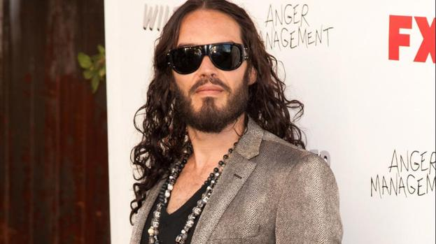 Russell Brand helps homeless man