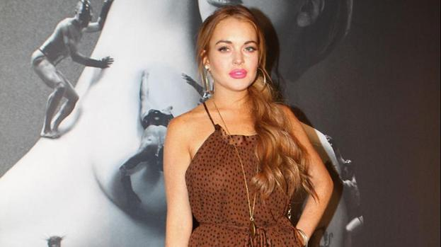 Lindsay Lohan's dad comments on mother's interview