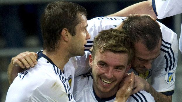 Shaun Maloney (left) and Steven Fletcher (right) hail Scotland scorer James Morrison