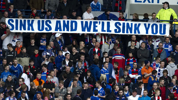 "Rangers fans with ""sink us and we'll sink you"" banner."