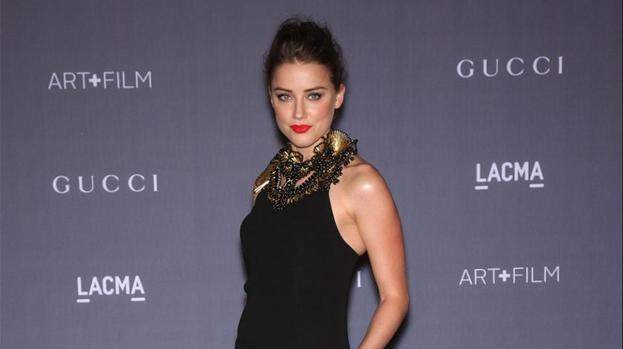 Amber Heard joins Three Days to Kill