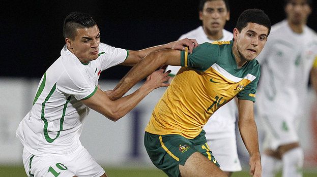 Australia's Tom Rogic fends off Iraq's Yaseen during their Olympic Games AFC Asian qualifying match in Gosford