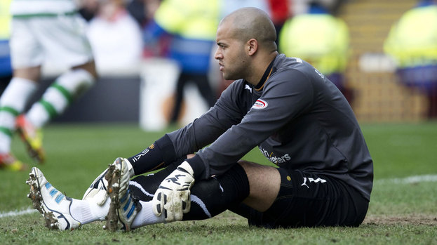 Darren Randolph sitting on the turf at Motherwell.