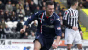 Ross County's Ivan Sproule wheels away to celebrate his second goal.