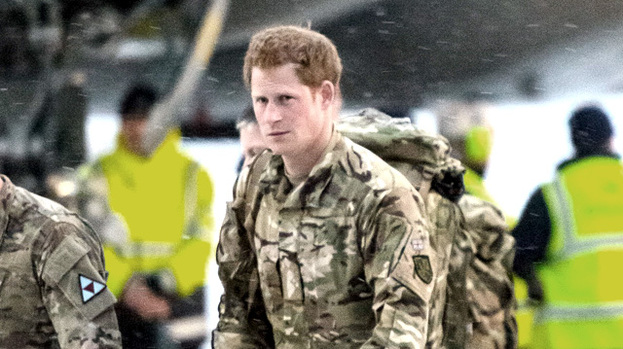 Prince Harry arriving at RAF Brize Norton after returning from a tour of duty in Afghanistan on a Voyager transport aircraft. 23 Jan 2013
