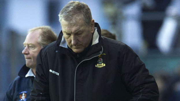 ICT manager Terry Butcher seems dejected as he heads for the dressing room at full time.