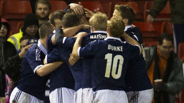 Scotland manager Gordon Strachan gave a nod to Germany's system with his starting line-up.