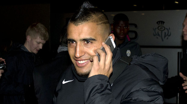 Juventus ace Arturo Vidal is all smiles as he arrives in Glasgow ahead of the Champions League clash with Celtic.