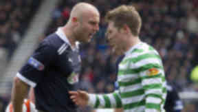 Raith Rovers' Simon Mensing (left) has words with Kris Commons after conceding a penalty.