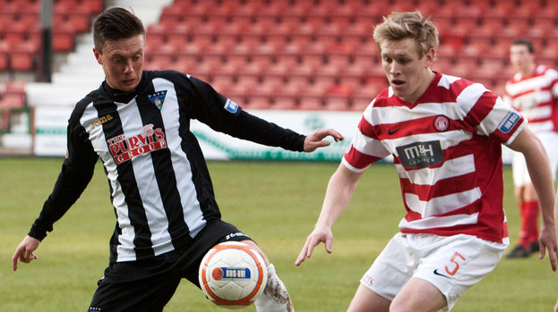 Dunfermline's Joe Cardle (left) holds off Jonathan Page.