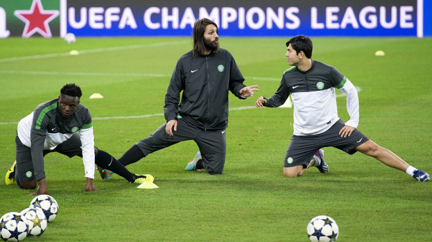 Celtic ace Georgios Samaras (centre) chats with team mate Miku as they train in the Juventus Stadium ahead of the Champions League Last 16 second leg clash with the Turin side.
