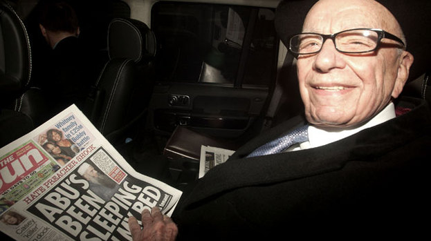 Paper man: Rupert Murdoch out and about with a copy of his paper The Sun