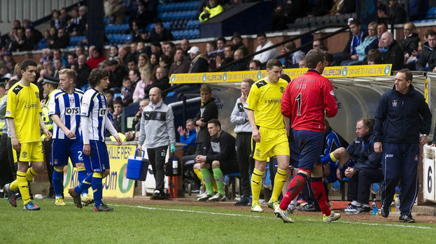 Both sets of players make their way off the park after a fan fell ill in the stand