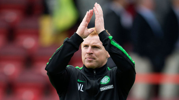 Celtic manager Neil Lennon applauds the traveling support at full time