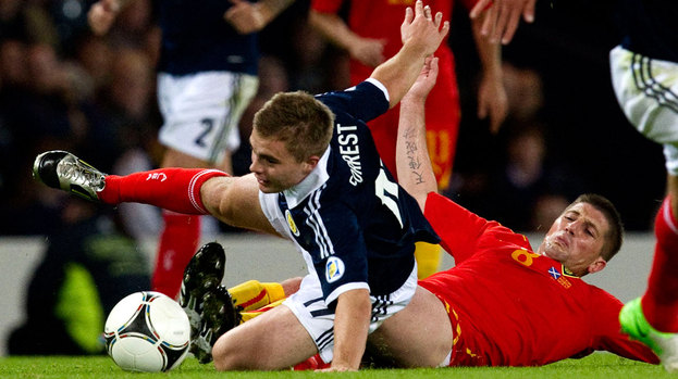 Scotland's James Forrest (left) is clipped by Veliche Shumulikoski.