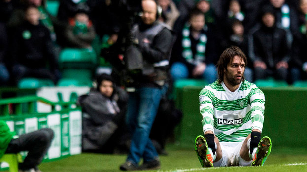 Georgios Samaras cuts a dejected figure on the touchline as Celtic suffer defeat to Aberdeen