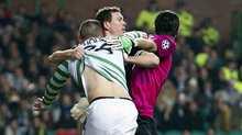 Celtic striker Gary Hooper (left) receives some rough treatment from Juventus pair Gianluigi Buffon (right) and Stephan Lichtsteiner