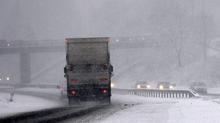 Lorry struggles in heavy snow on the M80.