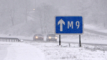 Snow causes low visibility on M80 on Friday morning.
